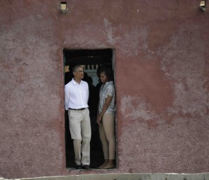 President Obama and first lady Michelle Obama look out of a doorway that slaves departed from on Goree Island in Dakar, Senegal on June 27, 2013. (REUTERS/Gary Cameron)